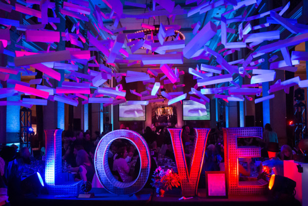 Installation by Paul Hayes (hanging above,) and Love by Laura Kimpton at the Artumnal Gathering, 2013. Photo courtesy of Marco Sanchez (marcosanchez.net)